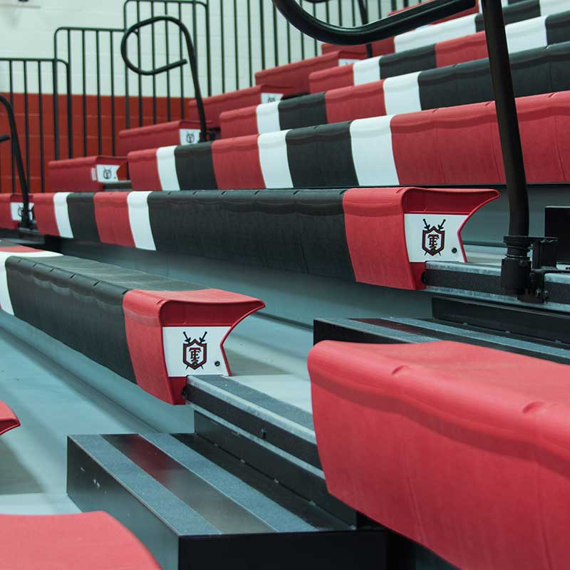 retractable bleachers red white black