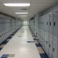 gray lockers on both sides of hallway