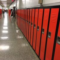 installed red and black tall lockers in hallway